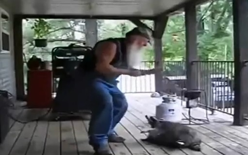 Video: Man Dancing With Raccoon