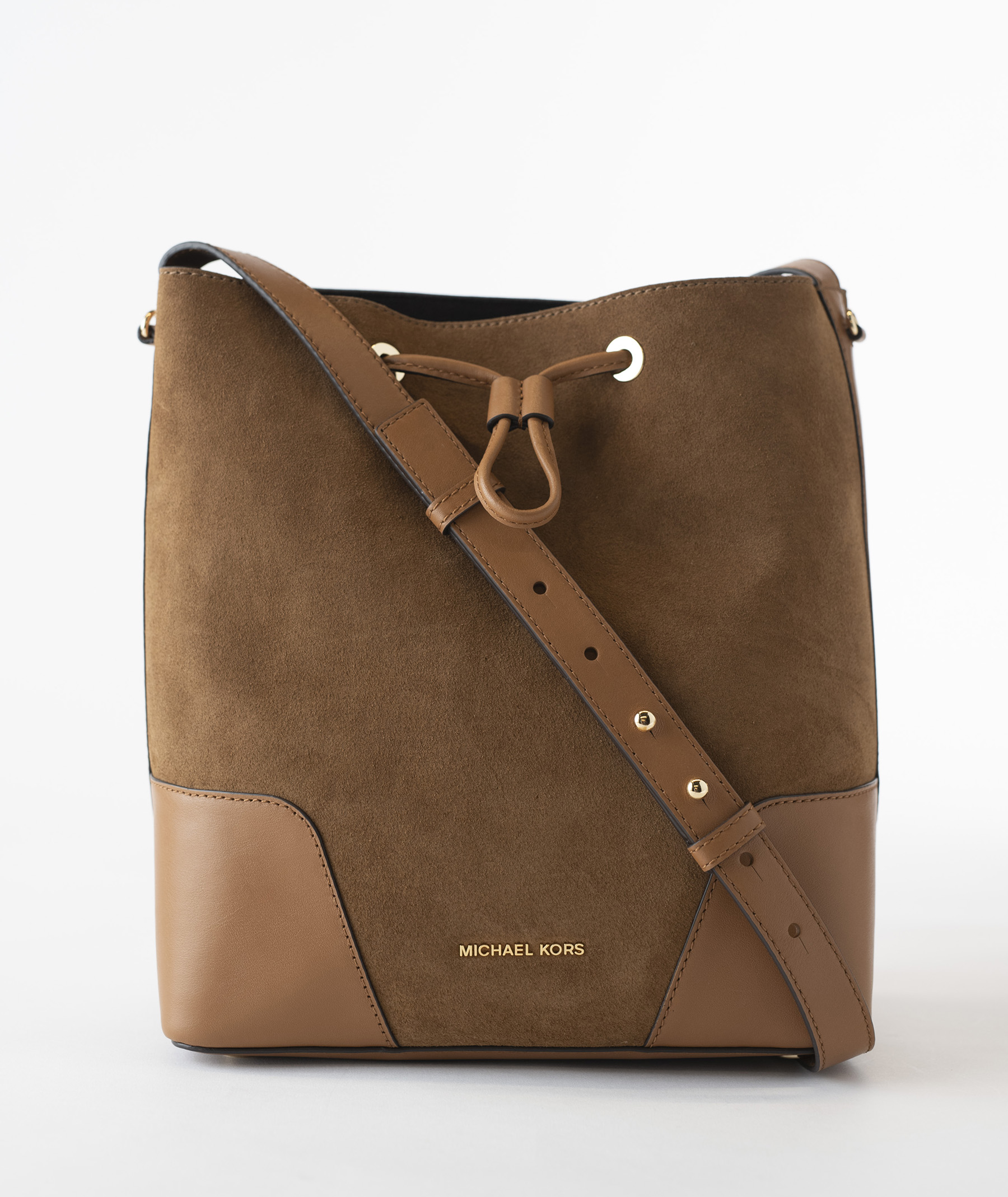 ded644f964f05 I m the Michael Kors Cary Medium Bucket Bag Leather. My slender design and  dark caramel color makes me the perfect purse to take with you this fall.